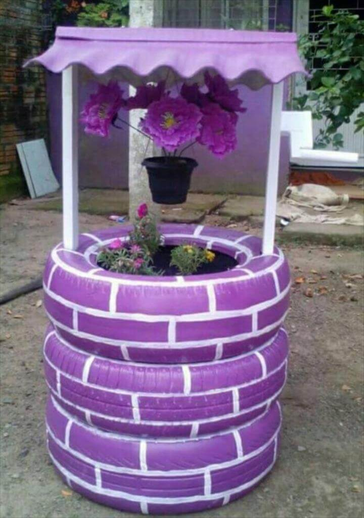 Wishing well planter made from recycled tires,