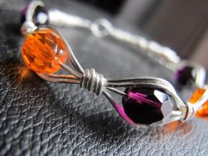 Wire wrapped jewellery designs: silver wire wrapped football bracelets!