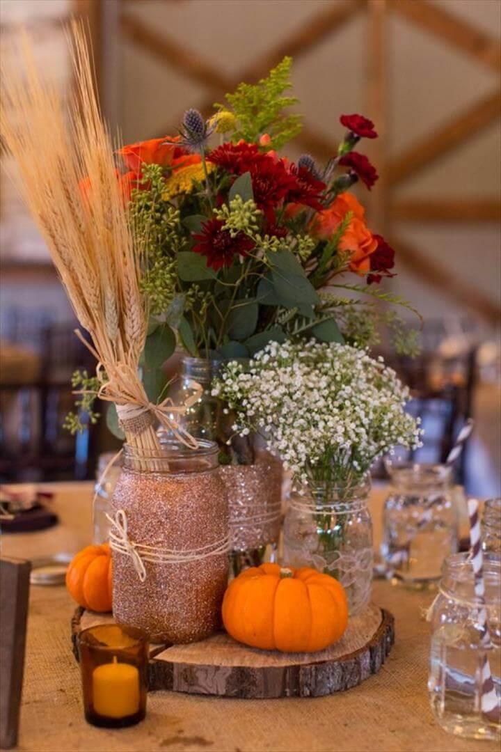 DIY Glitter mason jar fall wedding centerpiece with pumpkin and baby's breath's breath