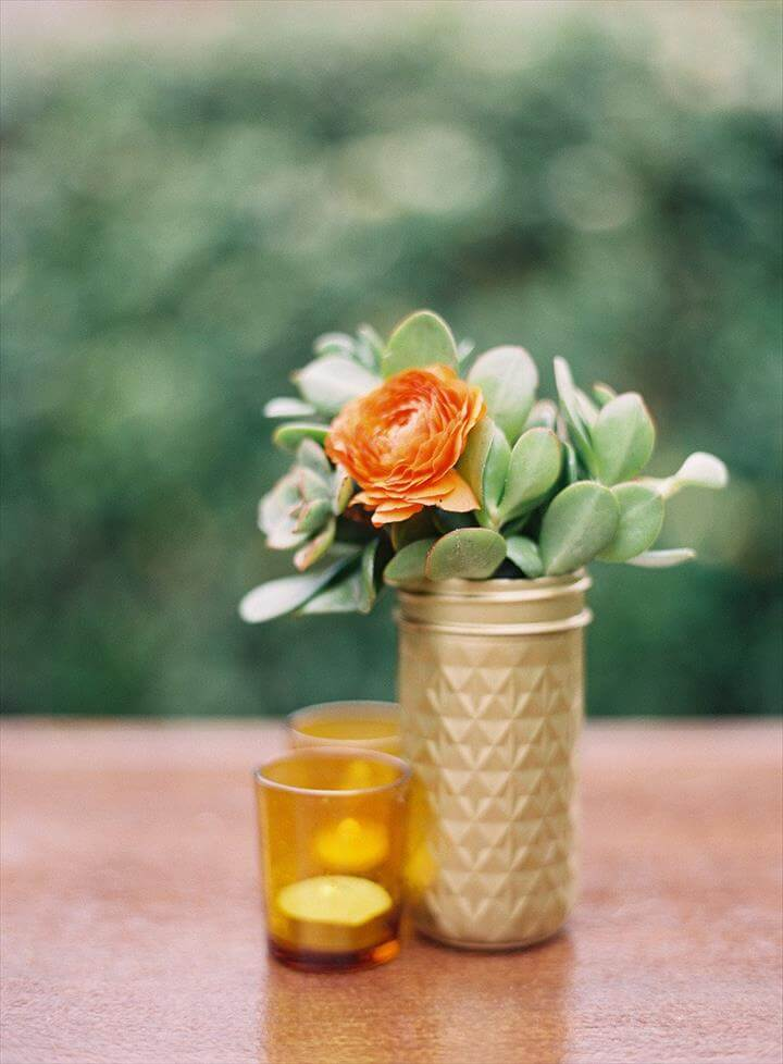 For an easy centerpiece, spray paint mason jars gold and fill with a succulent.