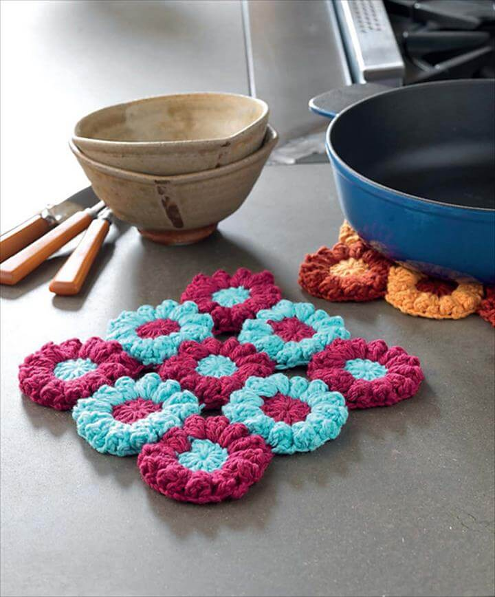 Secondly and thirdly are these homey items: flowering trivets and color block ottoman.