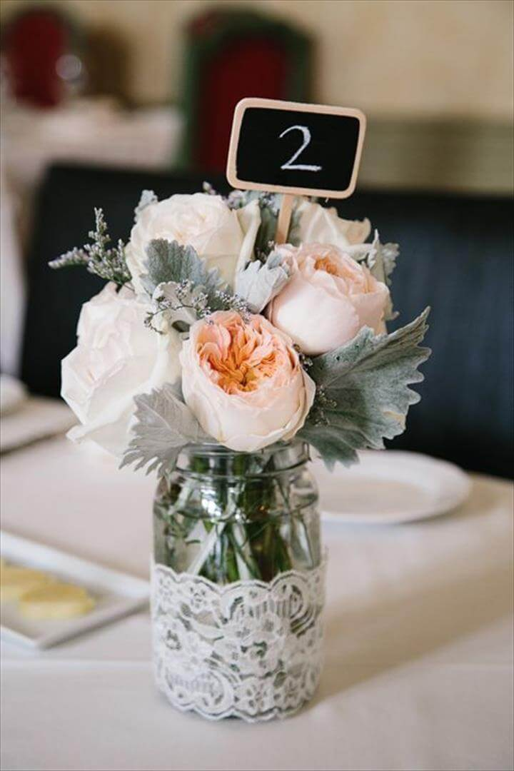 Romance was the order of the day thanks to these lush white centerpieces. Hollyflora arranged dense clusters of garden roses and peonies, which looked especially stunning in white marble vases for.