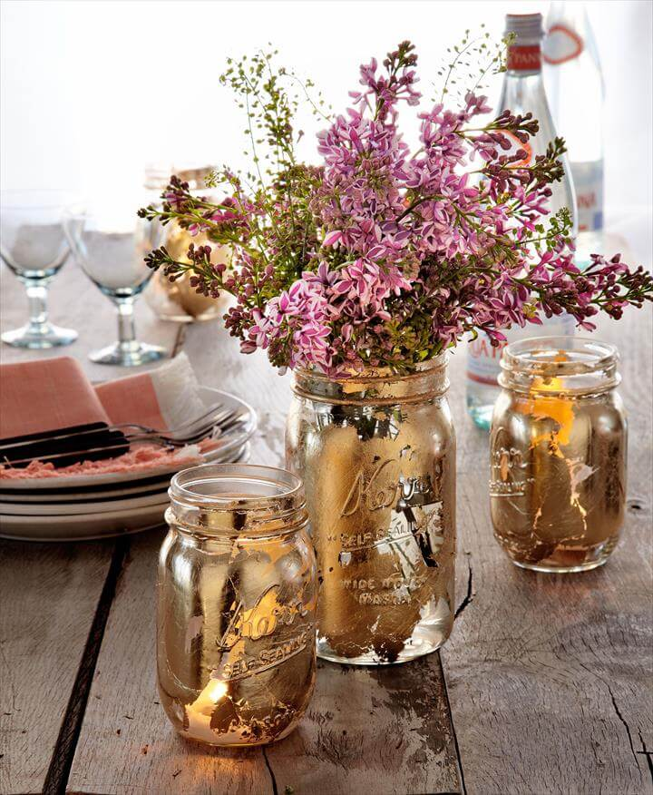 Upgrade your picnic table with gilded DIY vases and votives. Use a foam brush to