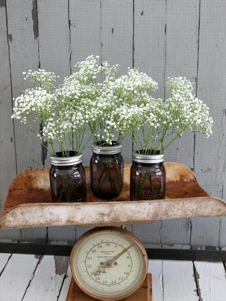 Möbeln Sie Ihr Zuhause auf, dekorieren Sie für eine Party oder machen Sie diese Mason Jar Centerpieces für