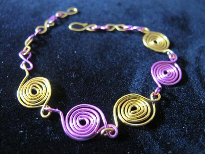 Funky wire wrapped bracelet with pink and yellow spirals and adjustable chain