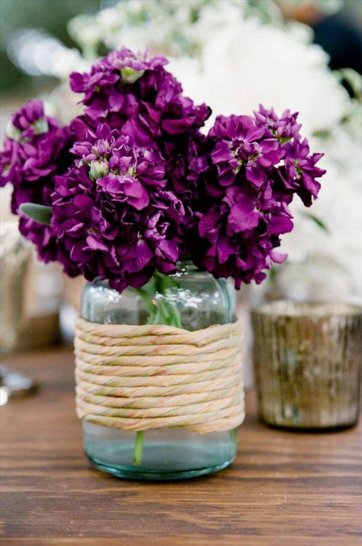 purple flowers in blue mason jar wedding centerpieces