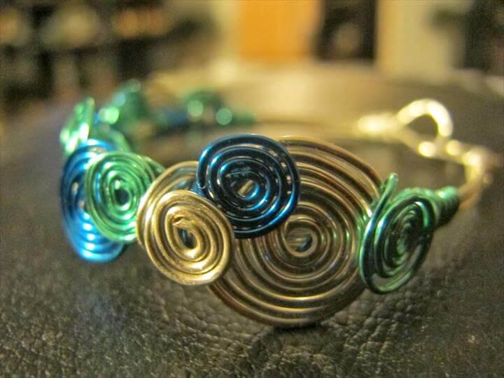 Silver wire wrapped peacock bracelet blue aqua spirals