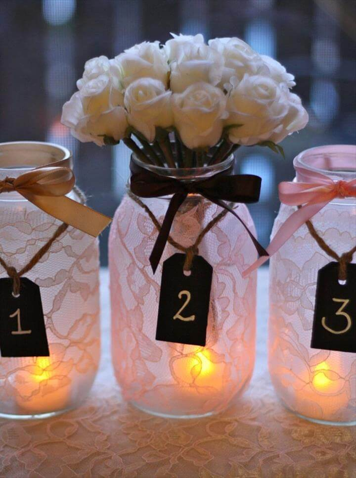 Wedding table decor with mason jar candle centerpieces