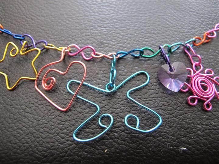 Wire wrapped rainbow charm bracelet: