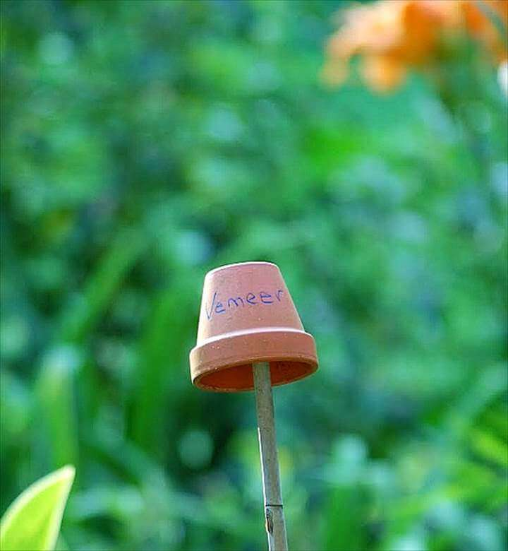 clay pot on a bamboo stick plant marker