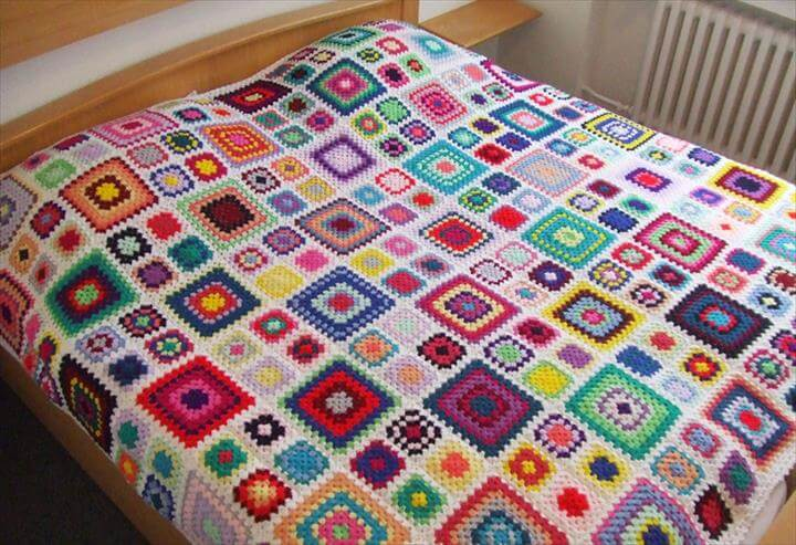 crocheted granny square blanket from my world of crochet .