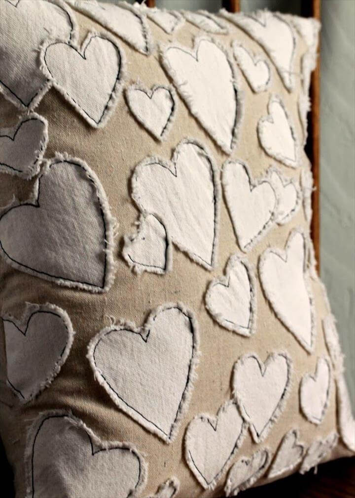Frayed hearts applique pillow. DIY sewing project inspired