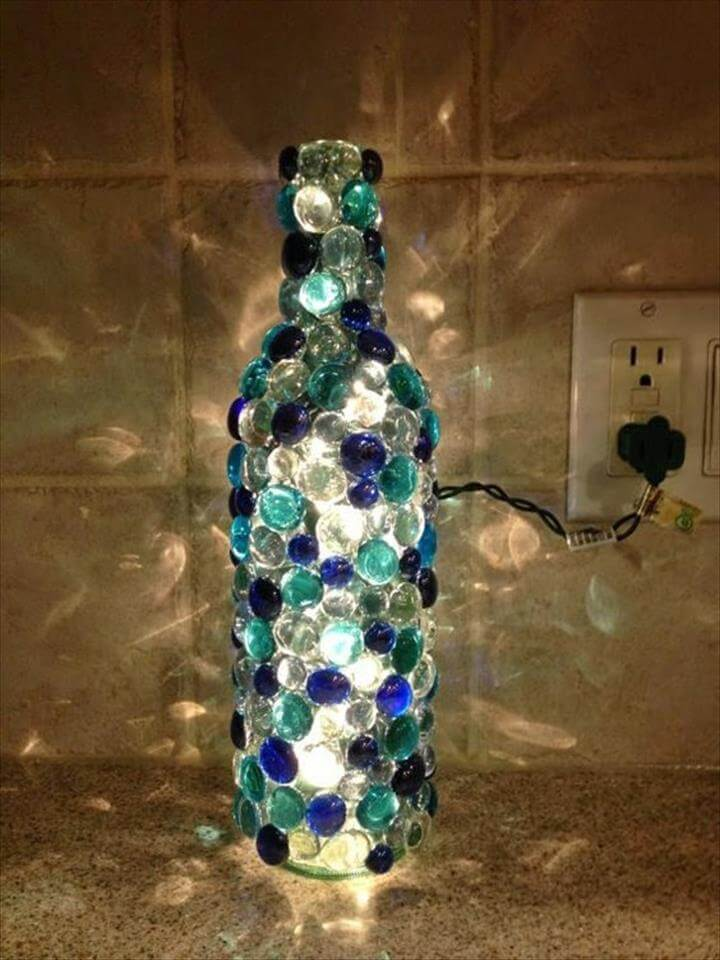 Glue glass beads to an old wine bottle to recreate this stunning design.