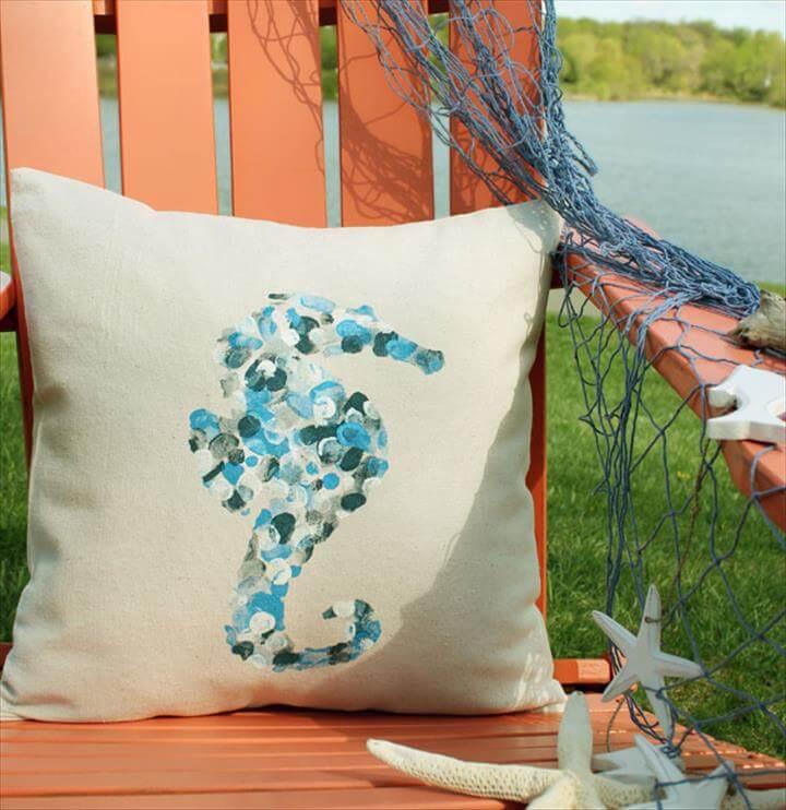 Thumbprint seahorse pillow