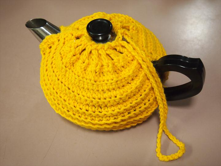 yellow crochet tea cozy