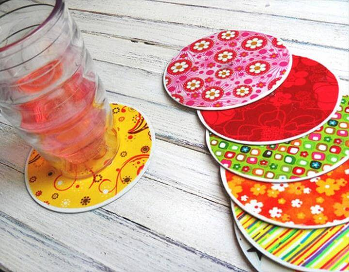 decorative coasters with colorful fabric pasted onto old CDs.