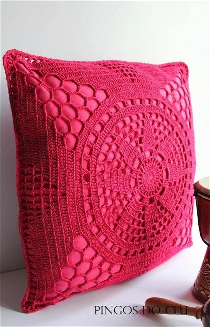 rasberry pink crochet covered cushion, could dye my doylies and do this
