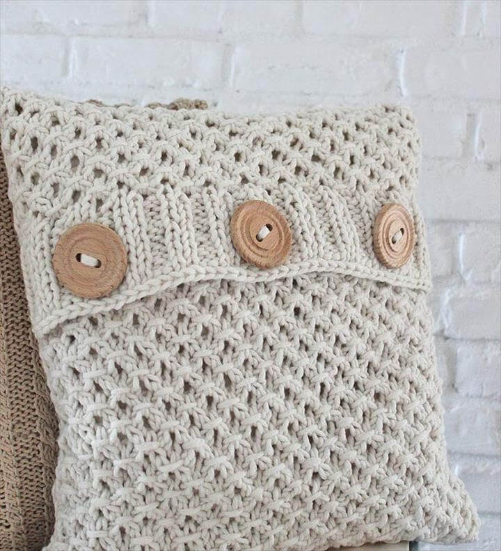 Knit textured pattern pillow covers and great buttons .