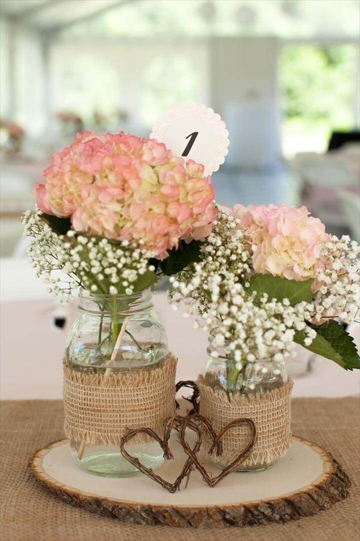 Centerpieces for our rustic country bridal shower. Mason jars .
