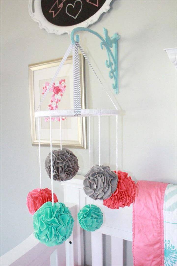 Fabric Pom-Pom Mobile, Project Nursery - Pom Pom Baby Mobile -- plant holder thing for attaching mobile