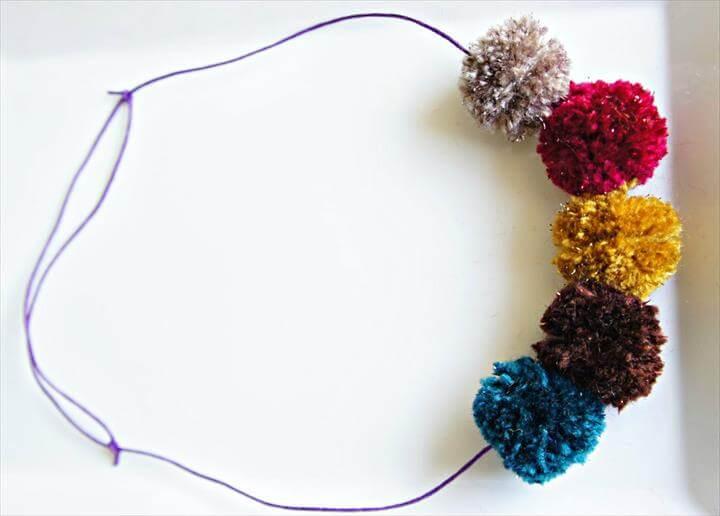 Sparkly pom poms on a slip necklace