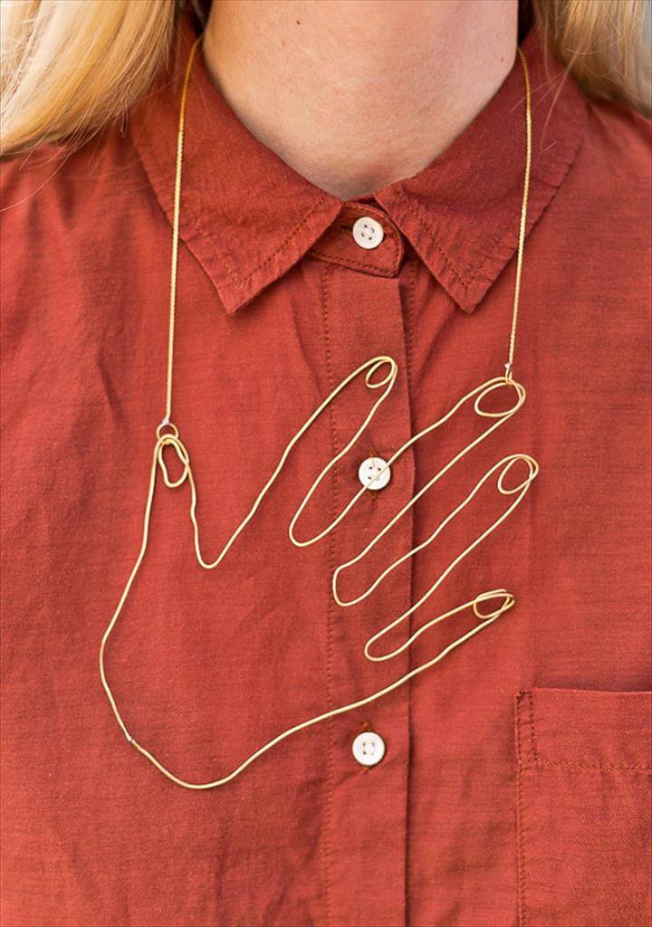 a wire hand necklace that you'll never want to take off