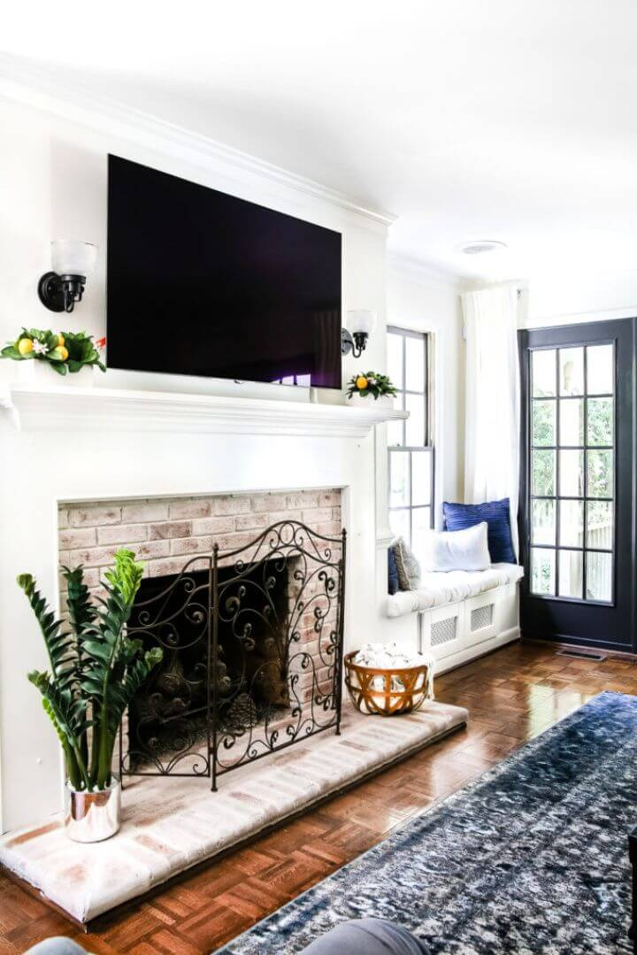 Create A DIY Lime Washed Brick Fireplace