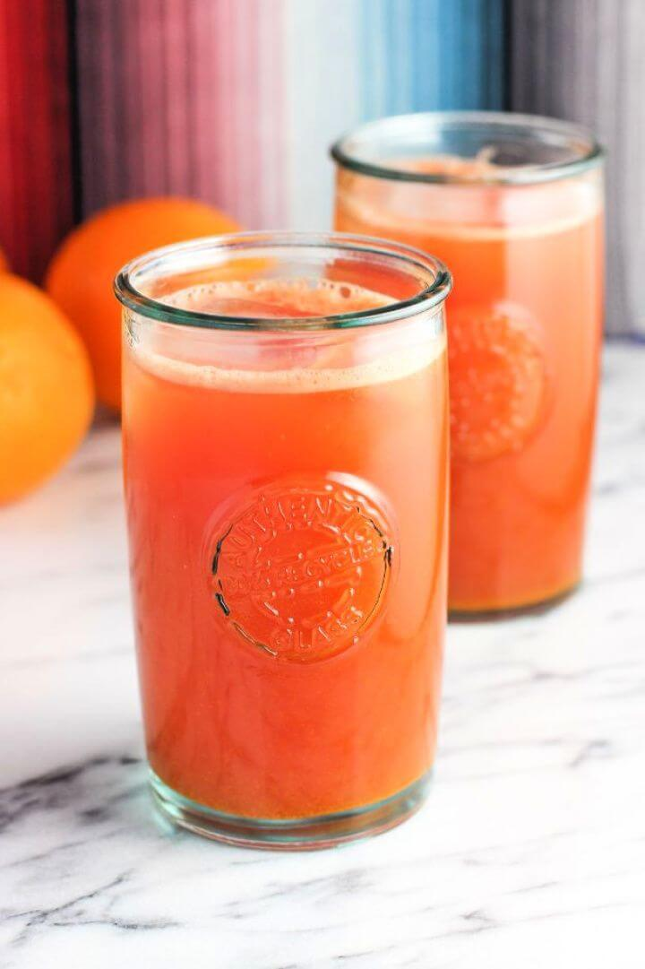 Make A DIY Watermelon Orange Ginger Turmeric Juice 4