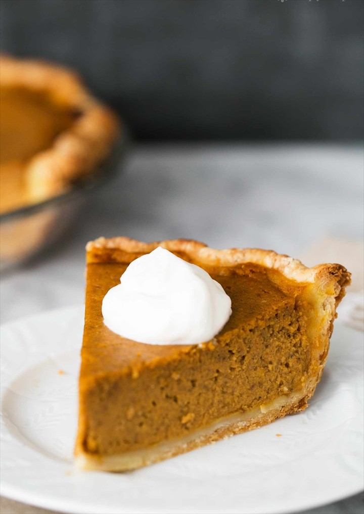 Pumpkin Pie Served with Whipped Cream