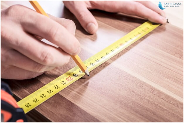 Take the measurements of the tabletop
